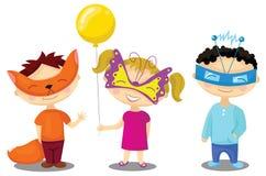 化妆舞会服装的孩子 免版税图库摄影