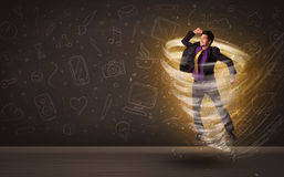 跳跃在龙卷风概念的愉快的商人 图库摄影