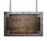 与被隔绝的金属框架的木中世纪标志 库存照片