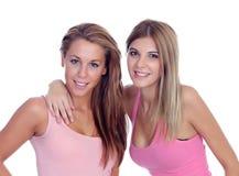 桃红色的两个美丽的女朋友 库存照片