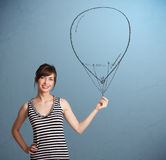 拿着气球图画的美丽的妇女 免版税库存图片