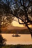 中国木休闲小船 西方杭州的湖 免版税图库摄影