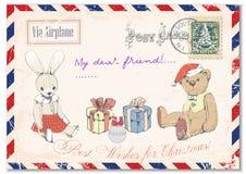 葡萄酒难看的东西明信片玩具熊女用连杉衬裤和兔子在明信片,问候圣诞快乐手图画  例证 库存图片