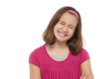 有眼睛的十几岁的女孩关闭了和暴牙的微笑 图库摄影