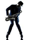 演奏萨克管演奏员剪影的人萨克斯管吹奏者 免版税库存照片