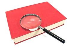 Античная лупа на Красной книге Стоковое Изображение
