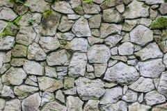 老石头墙壁  纹理被放置的石表面 免版税库存图片