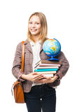 站立与袋子、书和地球的微笑的女孩 图库摄影