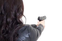 的妇女拿着枪的后面观点被隔绝在白色 免版税库存照片
