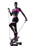 妇女健身步进抵抗结合锻炼剪影 免版税图库摄影
