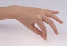 Χέρι γυναικών που απομονώνεται στο άσπρο υπόβαθρο Στοκ φωτογραφία με δικαίωμα ελεύθερης χρήσης