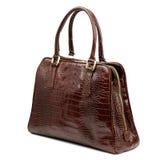 在白色背景隔绝的褐红的女性皮革提包 免版税库存照片