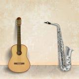 与吉他和萨克斯管的抽象音乐难看的东西背景 库存图片