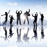 Бизнесмены группы празднуя жизнерадостную концепцию Стоковое Изображение RF