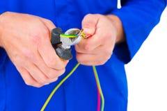 Провод вырезывания электрика с плоскогубцами Стоковые Фото