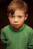逗人喜爱的微暗的清醒的年轻男孩 库存照片