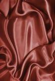 Ровный элегантный коричневый шелк шоколада как предпосылка Стоковое Изображение RF