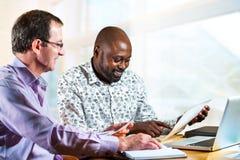 Разнообразные деловые партнеры работая совместно Стоковое Изображение