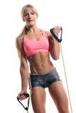 有锻炼带的健身辅导员 免版税图库摄影