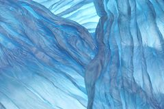 蓝色波浪织品纹理背景 图库摄影