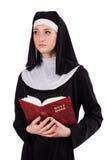 有圣经的年轻尼姑 免版税库存图片