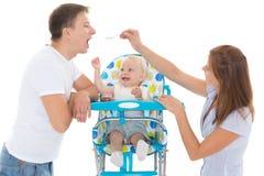 年轻父母饲料婴孩 库存图片