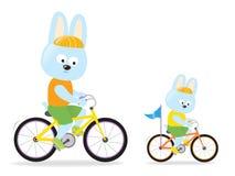 兔宝宝骑自行车 免版税库存照片