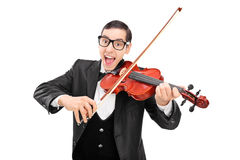 弹小提琴的快乐的音乐家 图库摄影