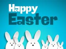 在蓝色背景的愉快的复活节兔子兔宝宝 库存图片
