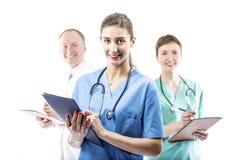 Τρεις ικανοί γιατροί έτοιμοι να βοηθήσουν Στοκ Εικόνα