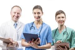 Τρεις ικανοί γιατροί έτοιμοι να βοηθήσουν Στοκ Εικόνες