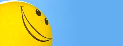 在天空的微笑的气球 免版税库存图片