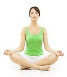 Женщина йоги в раздумье сидя в размышлять представления лотоса женский Стоковое фото RF