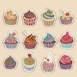 杯形蛋糕五颜六色的象 免版税库存照片