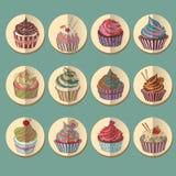 杯形蛋糕五颜六色的象 免版税图库摄影