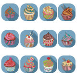 杯形蛋糕五颜六色的象 免版税库存图片