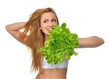 饮食的节食的概念美丽的少妇用健康食物 免版税库存图片