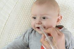 婴孩的鼻吸气器 免版税库存图片