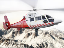 Ελικόπτερο διάσωσης κατά την πτήση πέρα από καλυμμένα τα χιόνι βουνά Στοκ Φωτογραφίες