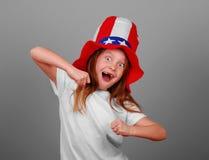 女孩愉快的帽子 免版税库存图片