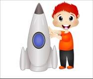 Мальчик играя с его игрушками ракеты Стоковое фото RF