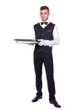 Νεαρό άτομο σε ένα κοστούμι που κρατά έναν κενό δίσκο απομονωμένο στο άσπρο β Στοκ εικόνα με δικαίωμα ελεύθερης χρήσης