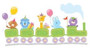 坐生日火车的动物 免版税库存照片
