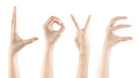Καθορισμένες θηλυκές χειρονομίες χεριών που κάνουν την ΑΓΑΠΗ λέξης Στοκ εικόνες με δικαίωμα ελεύθερης χρήσης