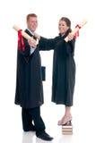 青少年夫妇的毕业 免版税库存图片
