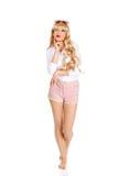 太阳镜的性感的体贴的白肤金发的妇女 免版税库存照片