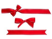 Красные ленты и смычки Стоковые Фото