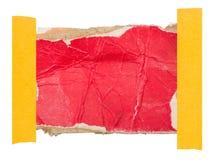 纸板标签附有与一卷稠粘的磁带 免版税库存照片