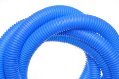 蓝色塑料波纹状的管子 免版税库存图片