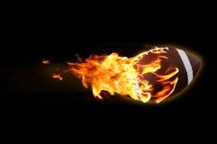 发火焰橄榄球 免版税图库摄影